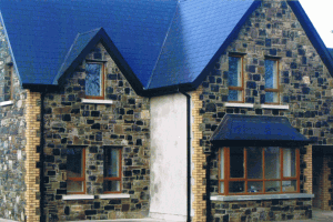 House faced with with Black and Blue Limestone, Yellow and Black coins and Granite