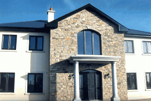 House with Cream Brown Sandstone with a Granite Porch