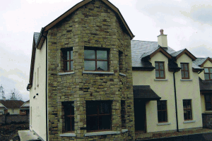 House faced with Cream, Brown and White Sandstone