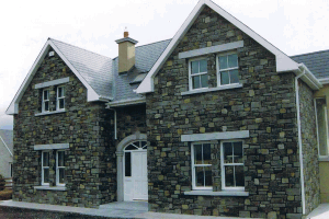House with Cream and Grey Sandstone with Granite heads and sills