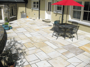 patio with multi sized and multicoloured sandstone paving slabs indian sandstone specialists